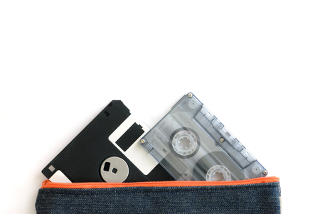 floppy disk and audio tape cassette in bag isolated on white background