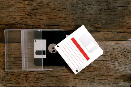 floppy disk in box on wooden floor
