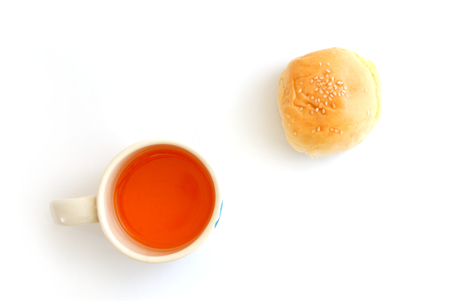 orange juice in cup and dessert on white background