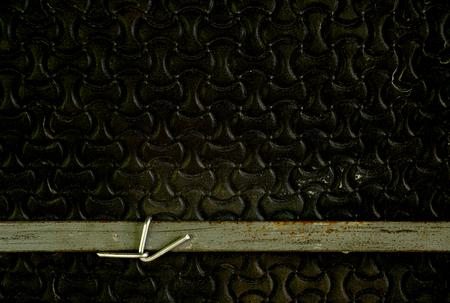 Flat steel wire tied to grunge rubber foam sheet.