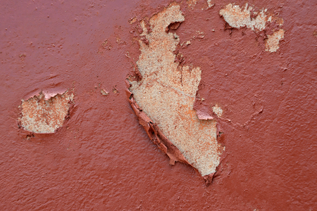 Cement wall with brown color paint and peeling. Stock Photo