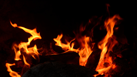 Closeup of fire flame and wood burning in  fireplace. Stock Photo