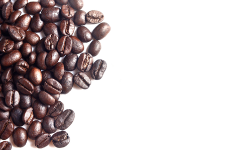 Brown coffee beans on white background.