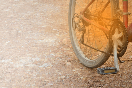 Bicycle wheel on a dirt road. Focus on transmission gear part.