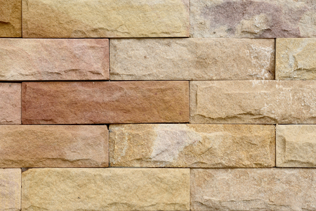 Sandstone brick wall surface closeup for background. Stock Photo