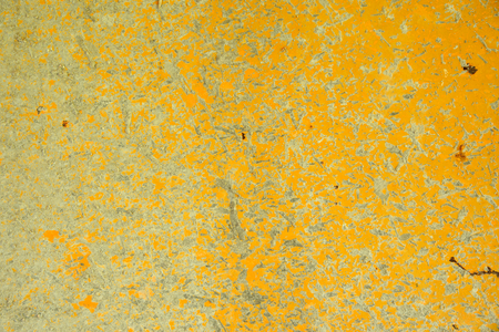 Yellow metal plate background with rust and cement stain. Stock Photo
