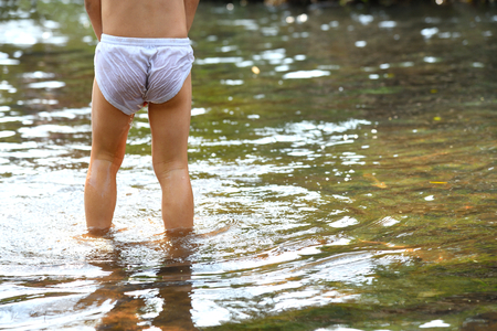 Back view of boy with white underpants.