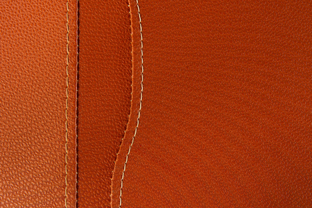 Orange leather with white stitch closeup for background.Part of leather motorcycle seat. 스톡 콘텐츠
