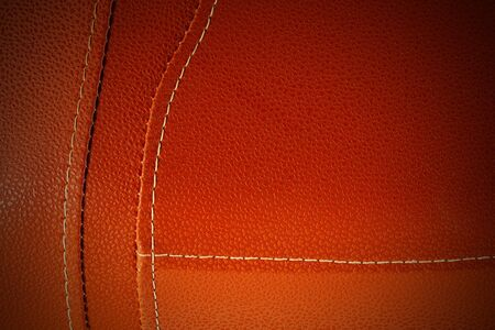 Orange leather with white stitch closeup for background.Part of leather motorcycle seat. 免版税图像