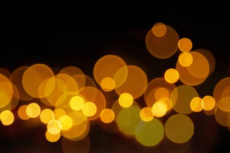 Golden color light of bokeh on black background.  Banque d'images