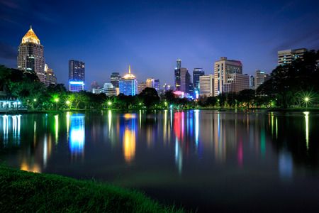 houston: Business district cityscape from a park with twilight time from lumpini park, Bangkok Thailand Editorial