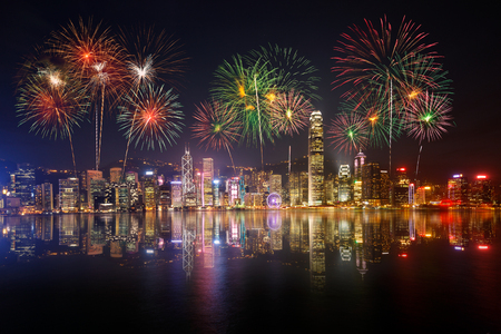 new building: Night view and fireworks at victoria harbour, Hong Kong Stock Photo
