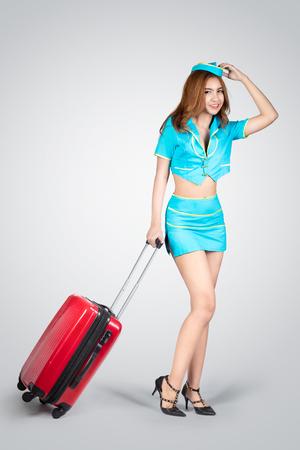 air hostess: belle jeune hôtesse de l'air, isolé sur fond gris