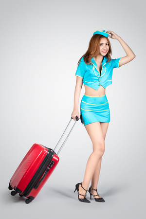 air hostess: Young beautiful air hostess, Isolated on grey background