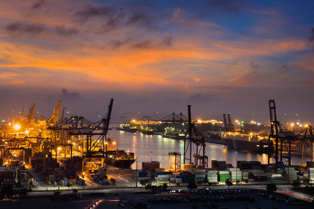 crane: Container Cargo freight ship with working crane bridge in shipyard at dusk for Logistic Import Export background