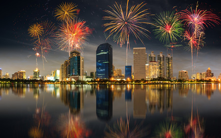 City town at night, Bangkok, Thailand with fire works Banco de Imagens