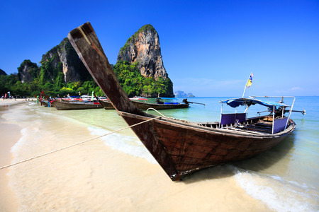 railay: Railay Beach, Tropical beach traditional long tail boat andaman sea thailand Stock Photo