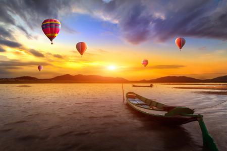 Hot air balloon over sunset sea