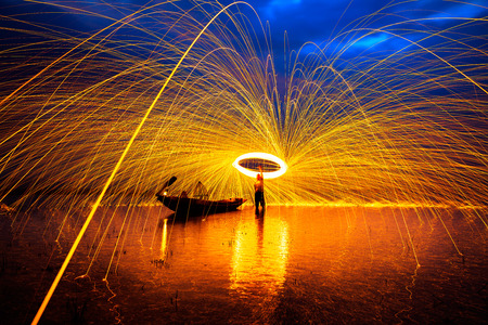 steel wool: Showers of hot glowing sparks from spinning steel wool Stock Photo