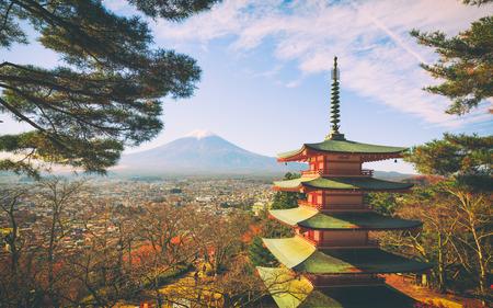 Mt. Fuji with red pagoda in autumn, Fujiyoshida, Japan, Mt. Fuji viewed from behind Chureito Pagoda. Stock Photo