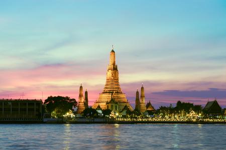 Wat Arun Temple at sunset in Bangkok Thailand.