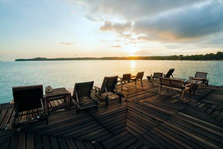 Deckchairs on a wooden bridge at sunset time in Kon Mak Thailand