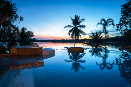 Beautifull luxury swimming pool near beach front, looking sea view and sunset time background