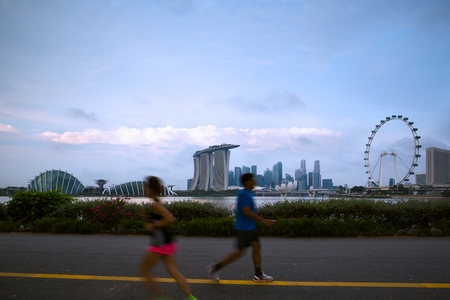 Blured people running in park at Marina Bay morning. Healthy lifestyle concept