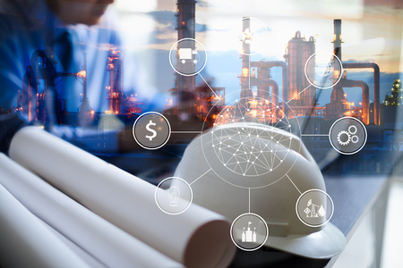 Double exposure of Engineer with oil refinery industry plant background, industrial instruments in the factory and physical system icons concept, Industry 4.0 concept image Stockfoto