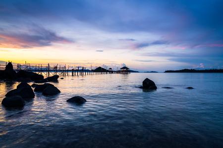 Long wooden bridge in tropical island beach at sunset Koh Mak, Trat Thailand