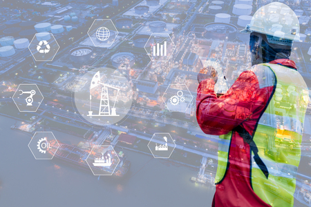 Double exposure of Engineer with oil refinery industry plant background, industrial instruments in the factory and physical system icons concept, Industry 4.0 concept image 免版税图像