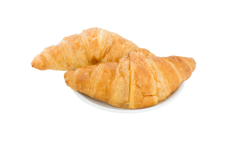 Croissant two pieces in a white dish isolated on a white background. Foods made from starch are carbohydrates that cause obesity. 스톡 콘텐츠
