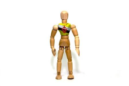 marioneta de madera: Wooden puppet with Brunei flag on body Foto de archivo
