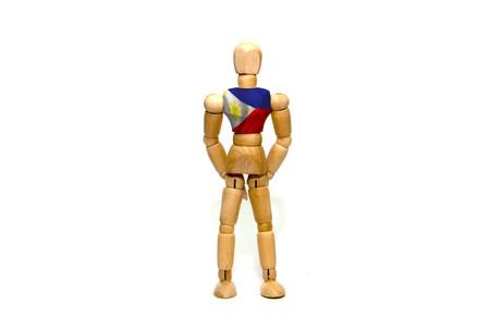 marioneta de madera: marioneta de madera con la bandera de Filipinas el cuerpo Foto de archivo