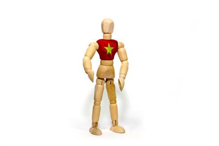 marioneta de madera: marioneta de madera con la bandera de Vietnam en el cuerpo Foto de archivo