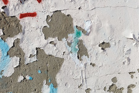 dumps: Texture of old stucco wall. Dumps paint and plaster. Bright sunlight