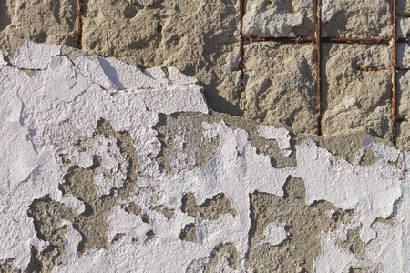 dumps: Texture of old stucco wall. Dumps paint and plaster, rusty fixtures. Bright sunlight