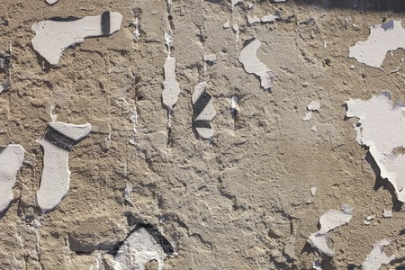 fixtures: Texture of old stucco wall. Dumps paint and plaster, rusty fixtures. Bright sunlight