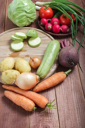 potato tree: Vegetarian food. Vegetables prepared for a meal on a wooden table. Round wooden board for cutting Stock Photo