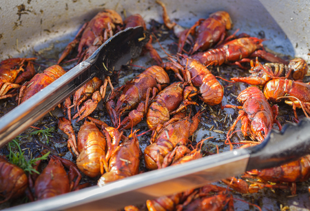 trade fair: Cooked crayfish in a large bowl. Street food, trade fair