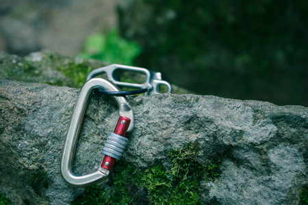 On the granite stone is a device for climbing insurance. Stock Photo
