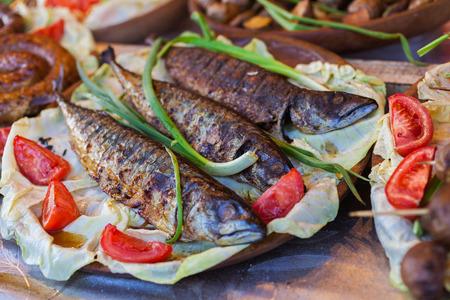 fish vendor: Fresh fried fish on a baking sheet. Street food