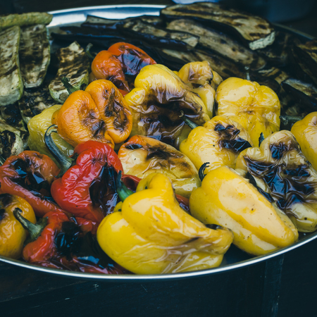 Freshly cooked grilled vegetables. Pepper, zucchini, eggplant.  Street sale of vegetables baked on the grill at the celebration