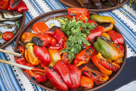 Red pepper grilled on a plate with seasonings and parsley