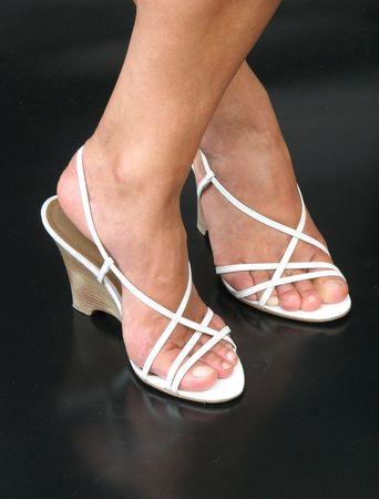 open toe: white sandals on dark background