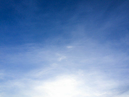 partly: Partly cloudy blue sky. Stock Photo