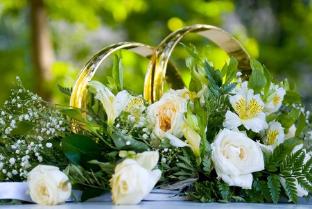 wedding car ornamentals with rings and flowers photo