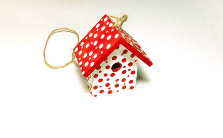 Red and white toy birdhouse Stock Photo - 8056644