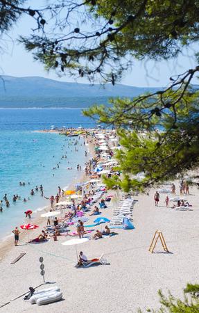 CROATIA, ISLAND BRACH - AUGUST 8, 2011  Zlatni Rat  Golden Cape  is a popular beach in the Town Bol which is on the south of the island of Brac in the Split-Dalmatia County of Croatia