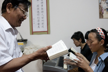 SERBIA, BELGRADE - JULY 23, 2013: Church service in the Chinese Baptist Church in Belgrade suburb Ledine. Baptist Christians are a religious minority both in China and Serbia.